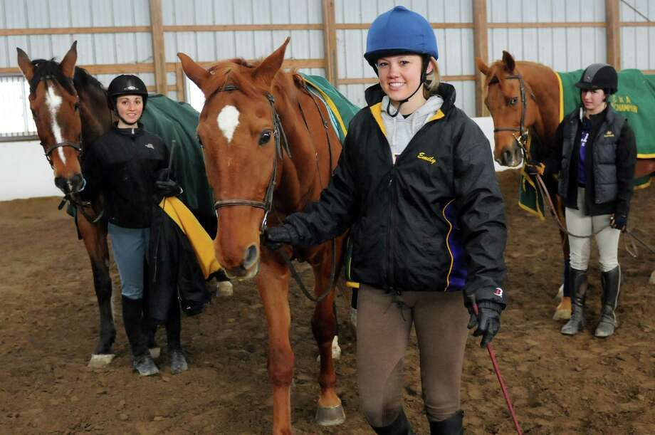 UAlbany Equestrian team competitors finish their jumping lesson on Wednesday, April 3, 2013, at Winter Glen Farm in Guilderland, N.Y. From left are Kathleen Lucere with Ted, Emily Kerley with Zee and Shelby Quackenbush with Ceasar. (Cindy Schultz / Times Union) Photo: Cindy Schultz / 00021818A