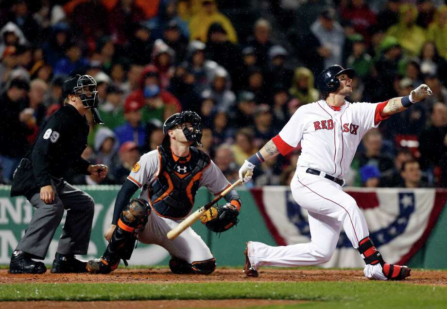 Boston Red Sox's Jarrod Saltalamacchia watches his RBI double in front of Baltimore Orioles' Matt Wieters in the second inning of a baseball game in Boston, Wednesday, April 10, 2013. (AP Photo/Michael Dwyer) Photo: Michael Dwyer