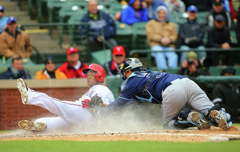 Texas' Adrian Beltre is tagged out by Jose Lobaton while trying to score on a fly ball in the eighth inning. Photo: Rick Yeatts / Getty Images