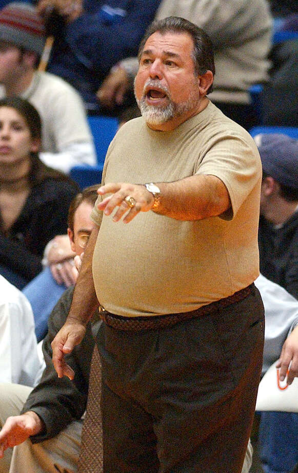 Jay head coach Romy Vela yells instructions to his players as they take on Judson in boys basketball regional quarterfinal at UTSA's Convocation Center on Feb. 26, 2003. Photo: Kin Man Hui, San Antonio Express-News / SAN ANTONIO EXPRESS-NEWS