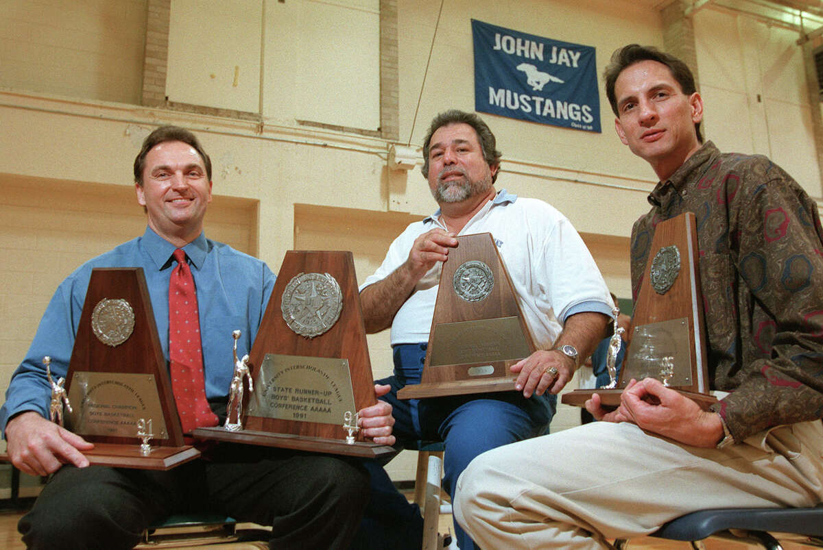 Current Jay basketball coach Romy Vela (center) is joined by former coaches David Stelmazewski and Steve Sylestine on March 8, 1999. Between the three, the team has won three regional championships. The fourth trophy is for the state runner-up.