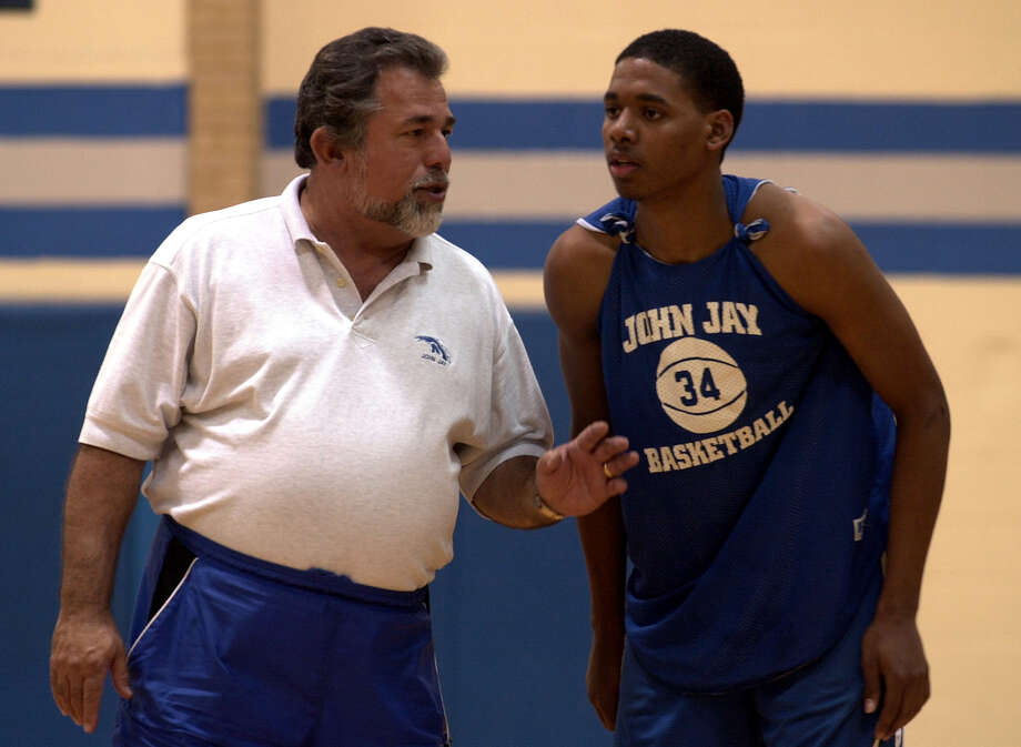Jay basketball head coach Romy Vela oversees practice on March 5, 2002. Vela has led his team to a spot in the Class 5A state semifinals. Photo: Kin Man Hui, San Antonio Express-News / SAN ANTONIO EXPRESS-NEWS