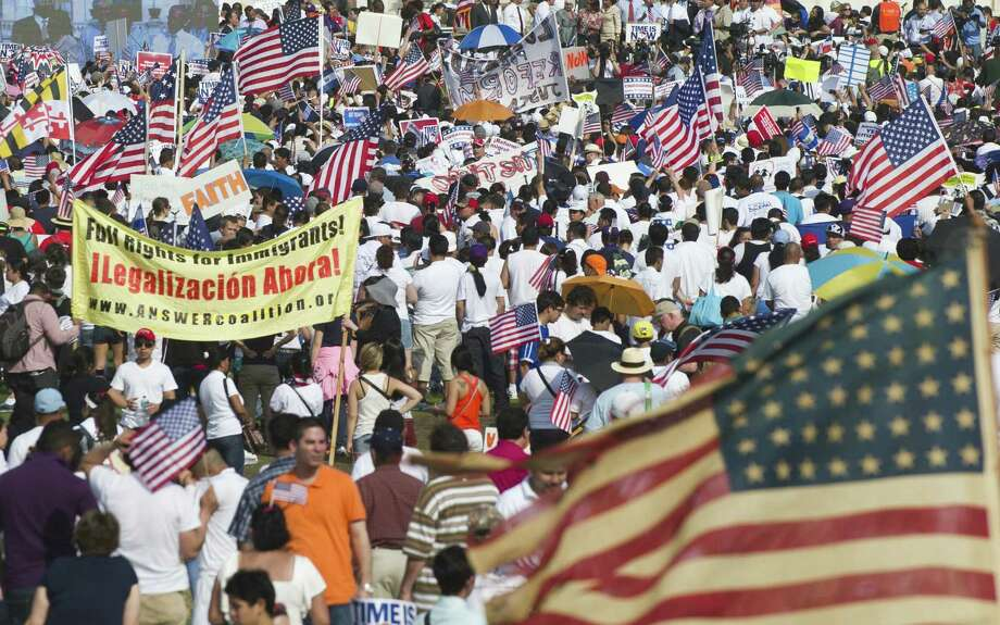 Tens of thousands of immigration reform supporters appear on the west lawn of the U.S. Capitol, with Democratic Reps. Joaquín Castro of San Antonio, Lloyd Doggett of Austin and Ruben Hinojosa of Mercedes among the lawmakers making appearances. Photo: Saul Loeb / AFP / Getty Images