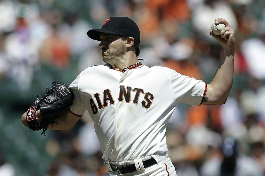 The Giants' Barry Zito allowed seven hits in seven innings, struck out four and walked one in a win. Photo: Jeff Chiu / Associated Press