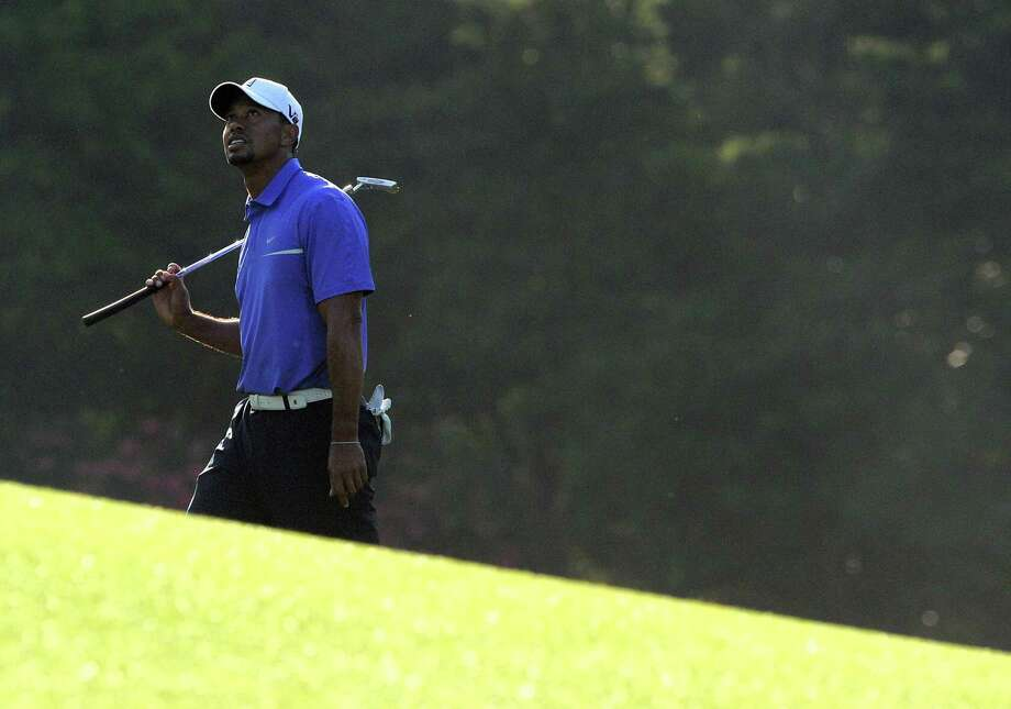 Tiger Woods, taking part in a practice round Wednesday, returns to the Masters as the No. 1 player in the world. He has not won at Augusta National since 2005. Photo: Jewel Samad / Getty Images