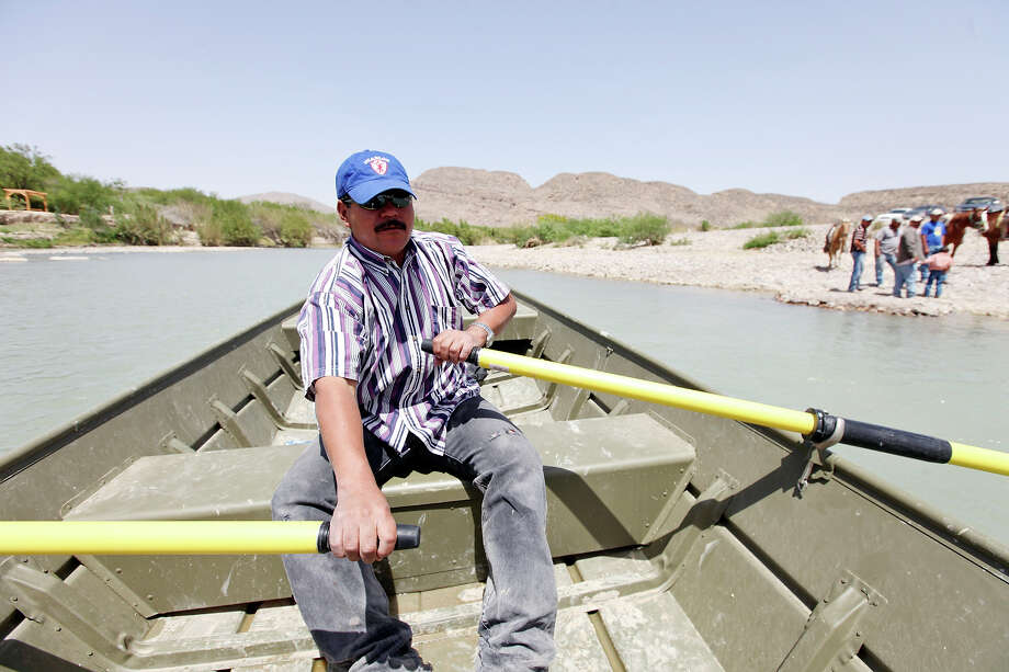 Adrian Valdez Cabello rows a boat across the Rio Grande from Boquillas del Carmen, Mexico to Big Bend National Park Wednesday April 10, 2013. Photo: Edward A. Ornelas, San Antonio Express-News / © 2013 San Antonio Express-News