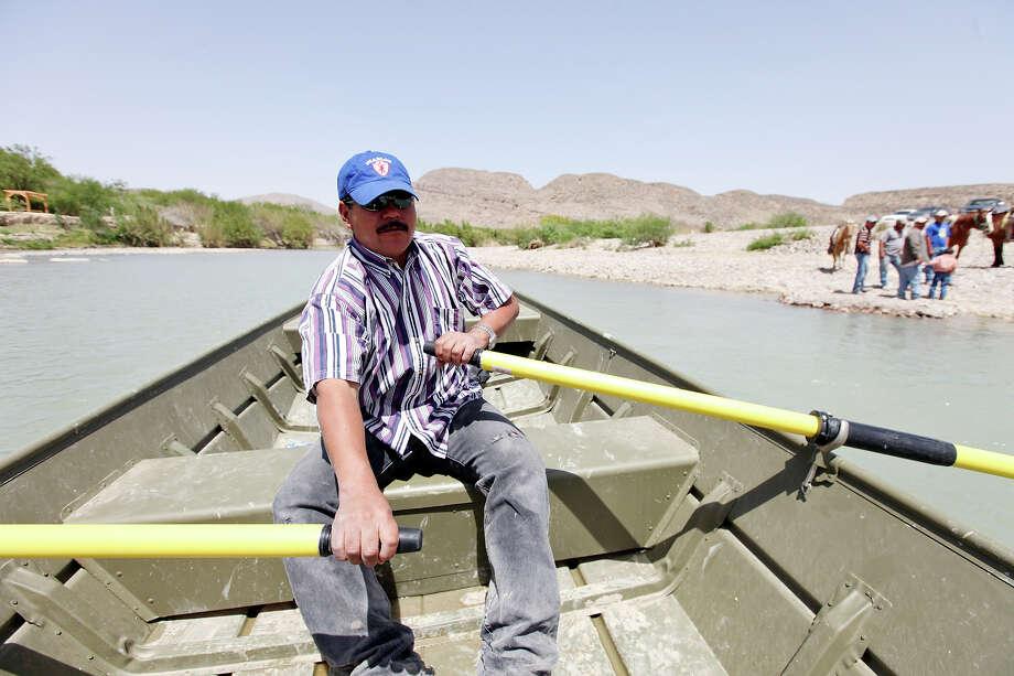Adrian Valdez Cabello rows a boat across the Rio Grande from Boquillas del Carmen, Mexico to Big Bend National Park Wednesday April 10, 2013. Photo: Edward A. Ornelas, San Antonio Express-News / © 2013 San Antonio Express-News