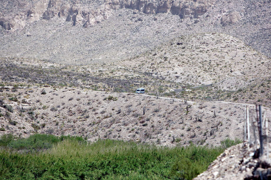 A vehicle in Big Bend National Park seen from Boquillas del Carmen, Mexico Wednesday April 10, 2013. Photo: Edward A. Ornelas, San Antonio Express-News / © 2013 San Antonio Express-News