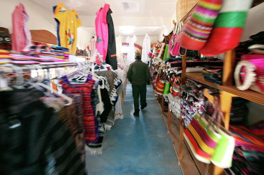 A Border Patrol agent walks through Jose Falcon's Restaurant & Mexican Curios Shop Wednesday April 10, 2013 in Boquillas del Carmen, Mexico. Photo: Edward A. Ornelas, San Antonio Express-News / © 2013 San Antonio Express-News