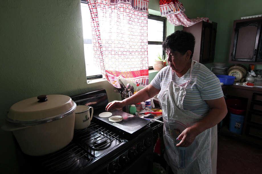 Ofelia Falcon, 70, cooks tortillas at Jose Falcon's Restaurant & Mexican Curios Shop Wednesday April 10, 2013 in Boquillas del Carmen, Mexico. Photo: Edward A. Ornelas, San Antonio Express-News / © 2013 San Antonio Express-News