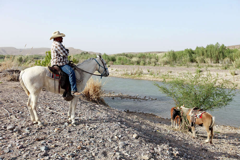 A resident of Boquillas del Carmen, Mexico watches people cross the Rio Grande to the town from Big Bend National Park Wednesday April 10, 2013. Photo: Edward A. Ornelas, San Antonio Express-News / © 2013 San Antonio Express-News