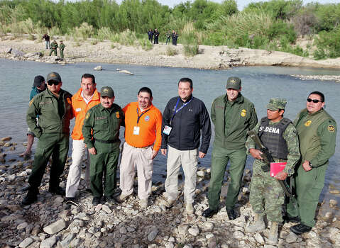 Officials pose for photos on the banks of the Rio Grande Wednesday April 10, 2013 in Boquillas del Carmen, Mexico. Photo: Edward A. Ornelas, San Antonio Express-News / © 2013 San Antonio Express-News