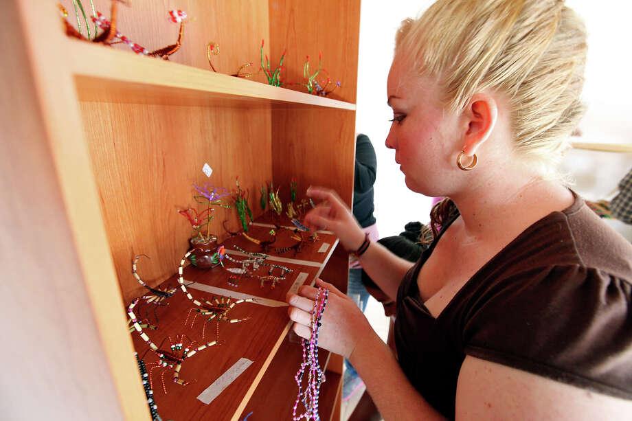 Lucero Noeli Diaz Luna arranges handicrafts for sale Wednesday April 10, 2013 in Boquillas del Carmen, Mexico. Photo: Edward A. Ornelas, San Antonio Express-News / © 2013 San Antonio Express-News