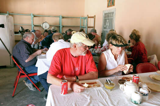 Doug (left) and Linda Buri, from Milbank, SD, eat at the Boquillas Restaurant Wednesday April 10, 2013 in Boquillas del Carmen, Mexico. Photo: Edward A. Ornelas, San Antonio Express-News / © 2013 San Antonio Express-News