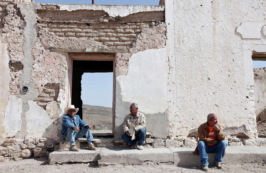 Boquillas del Carmen residents Catarino Ureste Vazquez, 71, (from left) Juan Gonzalez, 54, and Jose Marintez, 58, relax along the main road in Boquillas del Carmen, Mexico Wednesday April 10, 2013. Photo: Edward A. Ornelas, San Antonio Express-News / © 2013 San Antonio Express-News