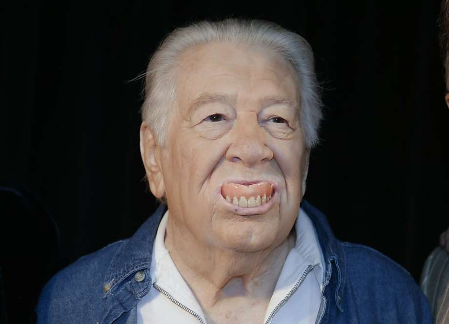 He's just teething:In Nashville, Cowboy Jack Clement pops his dentures out to amuse photographers after learning that he will be inducted into the Country Music Hall of Fame. Among other things, Clement discovered Jerry Lee Lewis and wrote hits for Johnny Cash, Dolly Parton and Elvis. Photo: Mark Humphrey, Associated Press