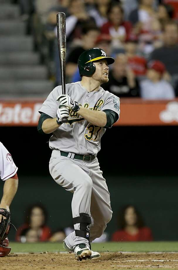 Brandon Moss admires his home run in the fifth inning. Moss finished with five RBIs. Photo: Chris Carlson, Associated Press