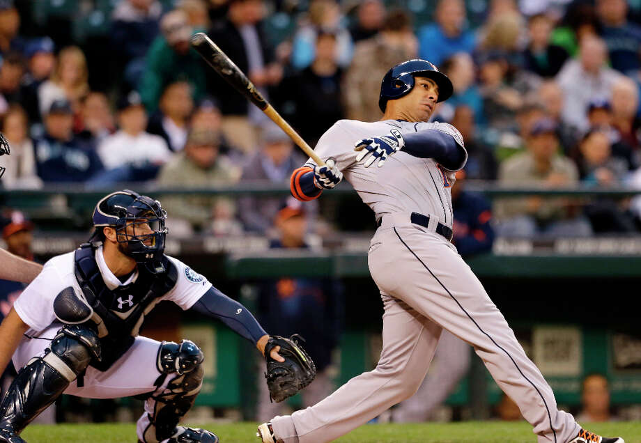 Carlos Pena of the Astros swings at a ball during the second inning. Photo: Elaine Thompson, Associated Press