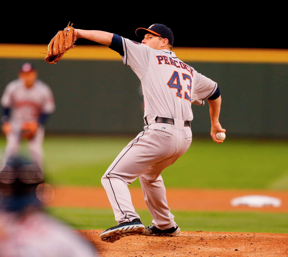 Astros pitcher Brad Peacock makes a throw during the first inning. Photo: Otto Greule Jr., 2013 Getty Images / 2013 Getty Images