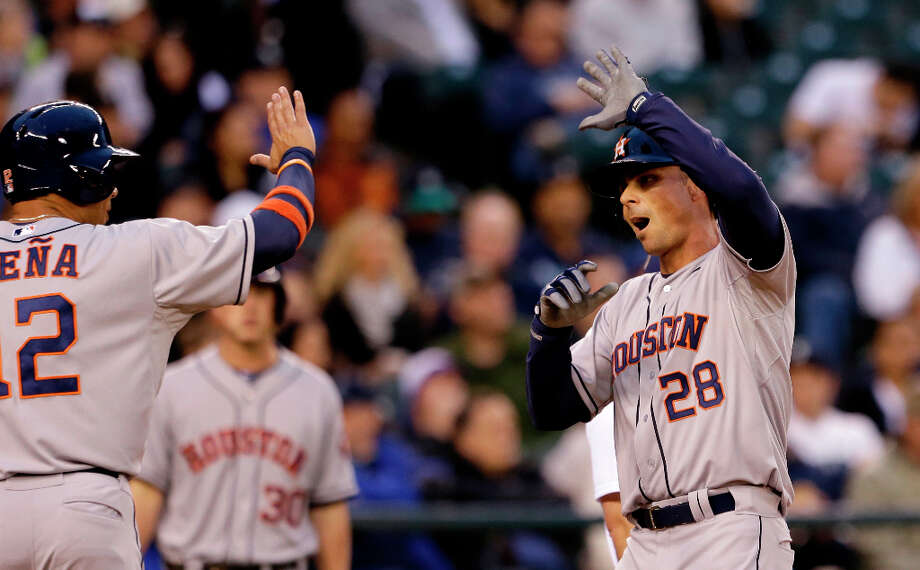 Rick Ankiel of the Astros is greeted at home plate by Carlos Pena after Ankiel\'s two-run homer. Photo: Elaine Thompson
