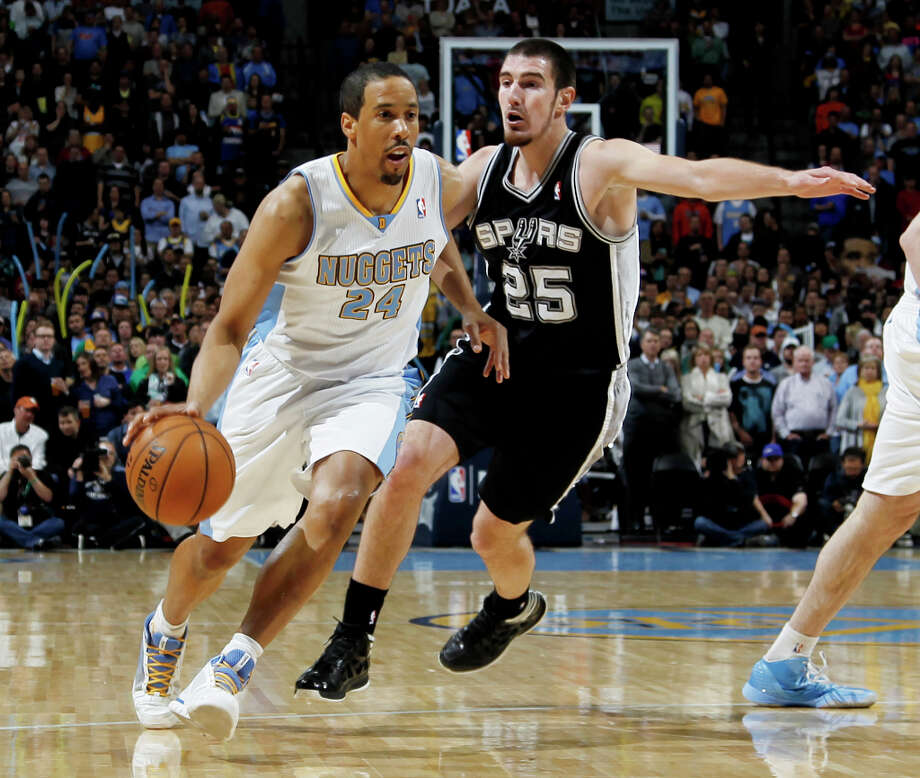 Denver Nuggets guard Andre Miller, left, drives past San Antonio Spurs guard Nando De Colo, of France, in the first quarter of an NBA basketball game in Denver, Wednesday, April 10, 2013. Photo: David Zalubowski, Associated Press / AP
