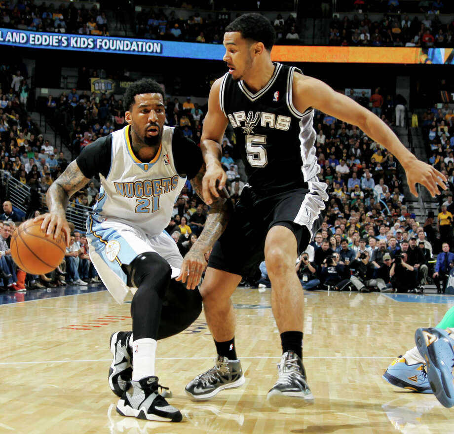 Denver Nuggets forward Wilson Chandler, left, drives against San Antonio Spurs guard Cory Joseph in the first quarter of an NBA basketball game in Denver, Wednesday, April 10, 2013. Photo: David Zalubowski, Associated Press / AP