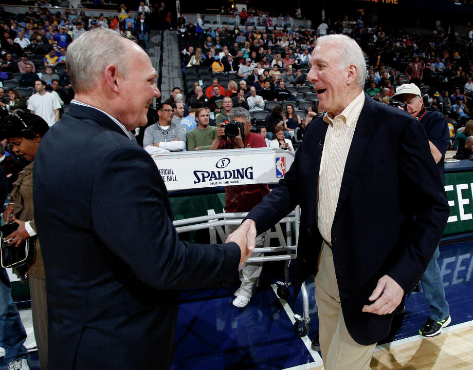San Antonio Spurs head coach Gregg Popovich, right, greets Denver Nuggets head coach George Karl before an NBA basketball game in Denver, Wednesday, April 10, 2013. Photo: David Zalubowski, Associated Press / AP
