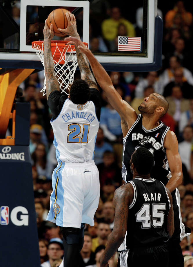 Denver Nuggets forward Wilson Chandler, left, goes up for basket as San Antonio Spurs forward Tim Duncan, back right, and center DeJuan Blair cover in the third quarter of the Nuggets\' 96-86 victory in an NBA basketball game in Denver on Wednesday, April 10, 2013. Photo: David Zalubowski, Associated Press / AP