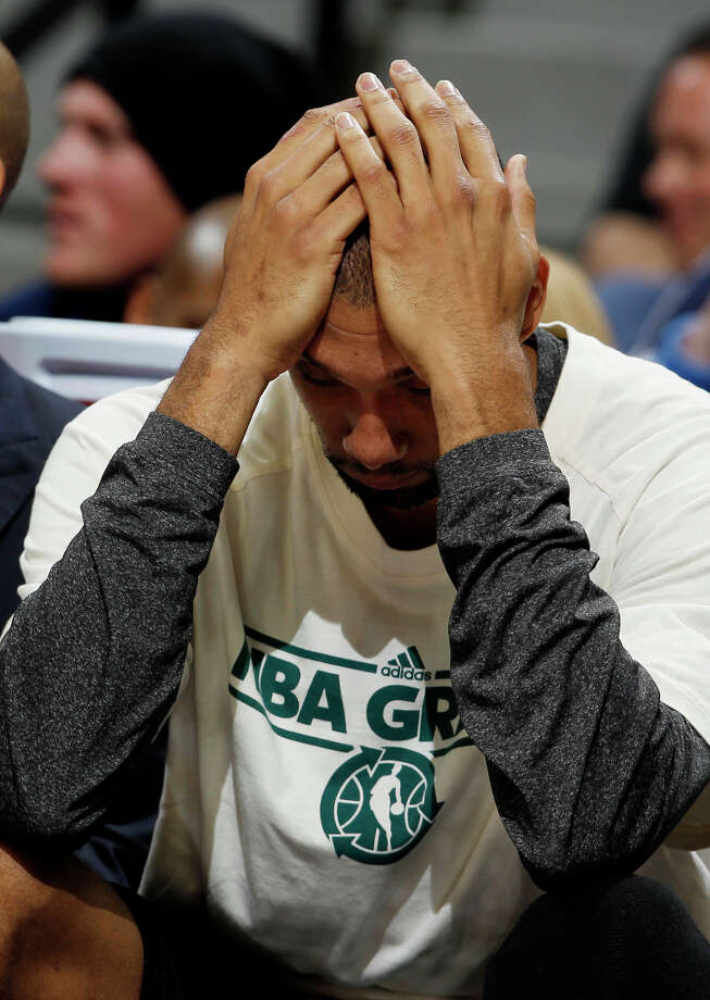 San Antonio Spurs forward Tim Duncan puts his hands on his head as the time runs out in the fourth quarter of the Denver Nuggets\' 96-86 victory over the Spurs in an NBA basketball game in Denver on Wednesday, April 10, 2013. Photo: David Zalubowski, Associated Press / AP