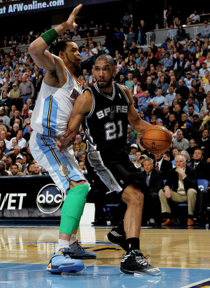 San Antonio Spurs forward Tim Duncan, right, works the ball inside as Denver Nuggets forward JaVale McGee covers in the third uarter of the Nuggets\' 96-86 victory in an NBA basketball game in Denver on Wednesday, April 10, 2013. Photo: David Zalubowski, Associated Press / AP