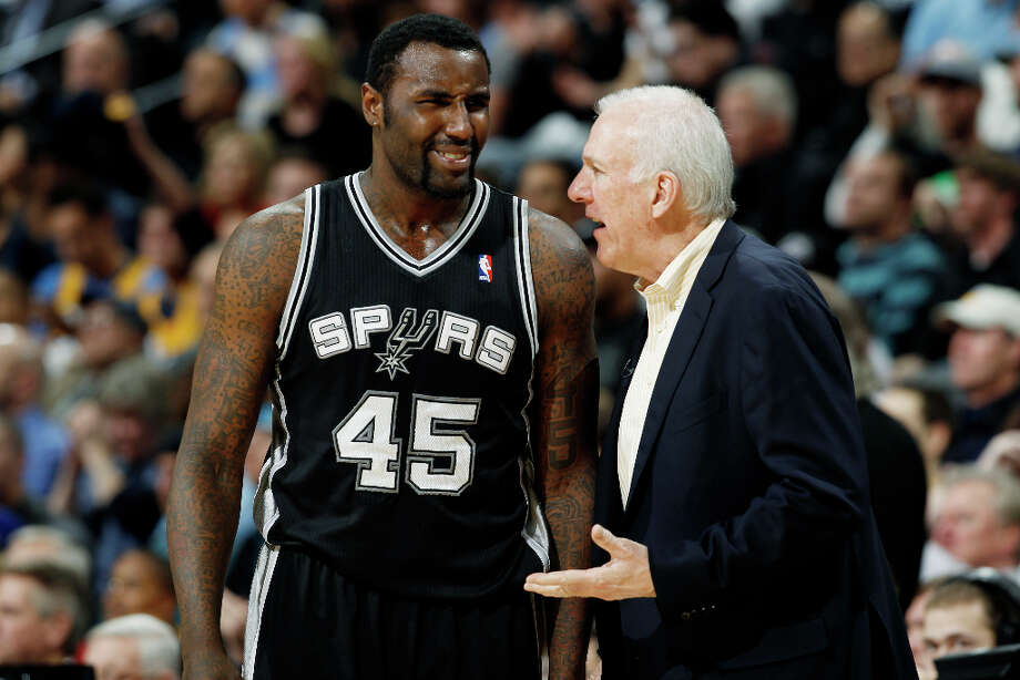San Antonio Spurs center DeJuan Blair, left, confers with head coach Gregg Popovich in the fourth quarter of the Denver Nuggets\' 96-86 victory over the Spurs in an NBA basketball game in Denver on Wednesday, April 10, 2013. Photo: David Zalubowski, Associated Press / AP
