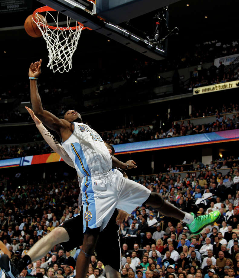 Denver Nuggets forward Kenneth Faried, front, collides with San Antonio Spurs center Aron Baynes as he goes up for a shot in the fourth quarter of the Nuggets\' 96-86 victory in an NBA basketball game in Denver on Wednesday, April 10, 2013. Photo: David Zalubowski, Associated Press / AP