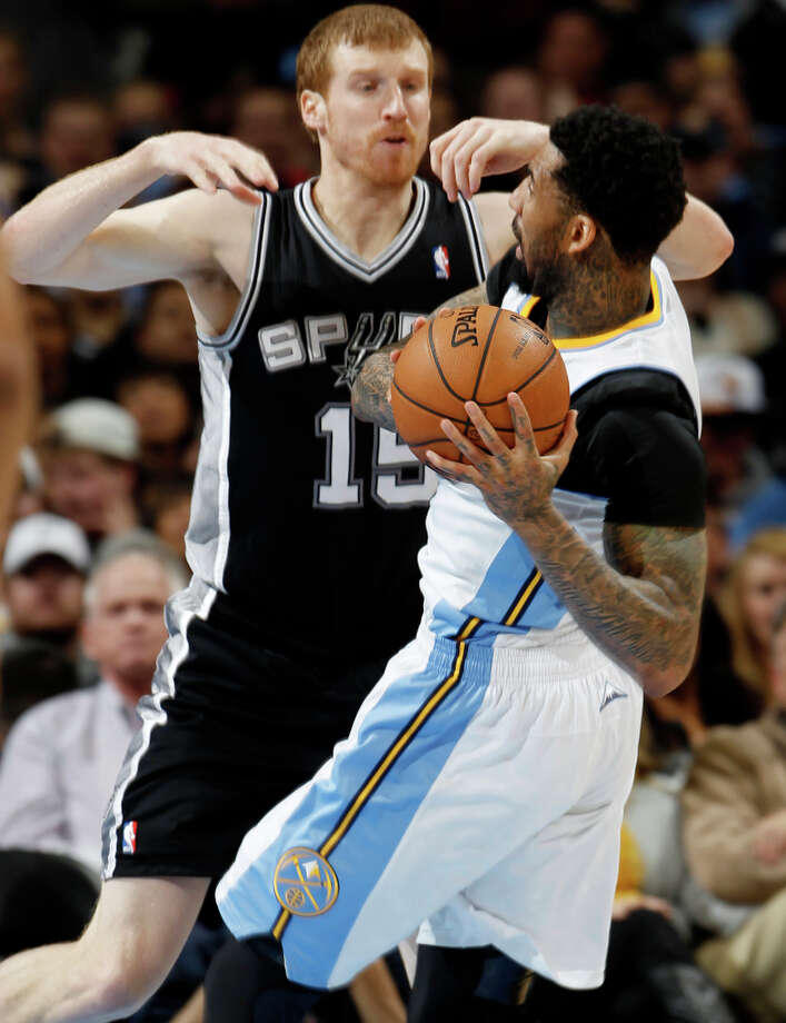 Denver Nuggets forward Wilson Chandler, front, is stopped as he drives for the basket by San Antonio Spurs forward Matt Bonner in the third quarter of the Nuggets\' 96-86 victory in an NBA basketball game in Denver on Wednesday, April 10, 2013. Photo: David Zalubowski, Associated Press / AP
