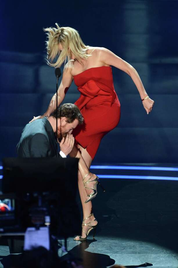 Michael Fassbender and Charlize Theron do a little fake fighting at the 2012 MTV Movie Awards at Gibson Amphitheatre on June 3, 2012 in Universal City, California.  (Photo by Jeff Kravitz/FilmMagic) Photo: Jeff Kravitz, FilmMagic / 2012 Jeff Kravitz