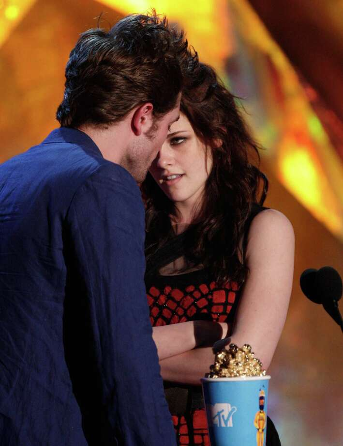 Actor Robert Pattinson (L) and actress Kristen Stewart accept the Best Kiss award onstage during the 18th Annual MTV Movie Awards held at the Gibson Amphitheatre on May 31, 2009 in Universal City, California. Photo: Kevin Winter, Getty Images / 2009 Getty Images