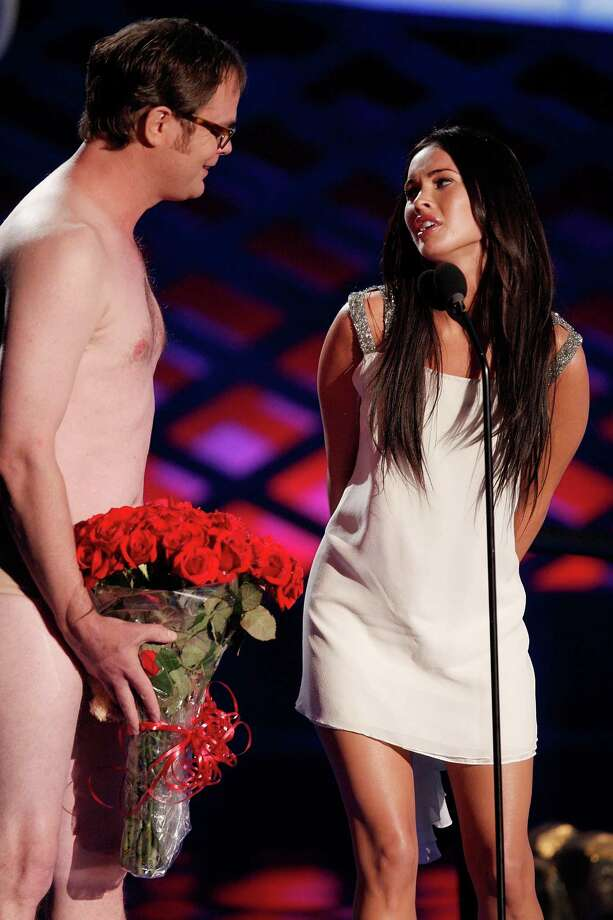 Actor Rainn Wilson attempts to woo Megan Fox present during the 17th annual MTV Movie Awards held at the Gibson Amphitheatre on June 1, 2008 in Universal City, California. Photo: Kevin Winter, Getty Images / 2008 Getty Images