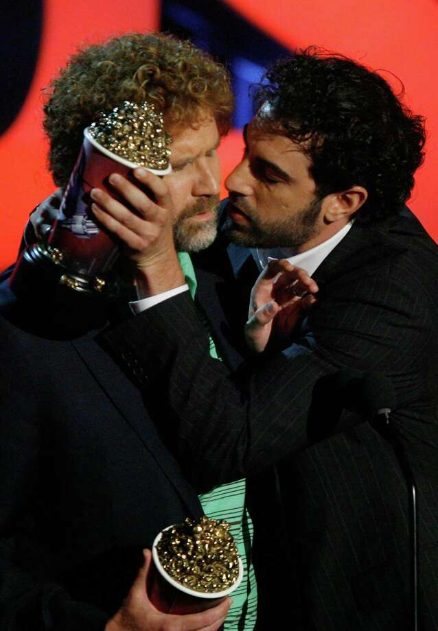 "Actors Will Ferrell (L) and Sacha Baron Cohen accept their award for ""Best Kiss"" onstage during the 2007 MTV Movie Awards held at the Gibson Amphitheatre on June 3, 2007 in Universal City, California. Photo: Kevin Winter, Getty Images / 2007 Getty Images"