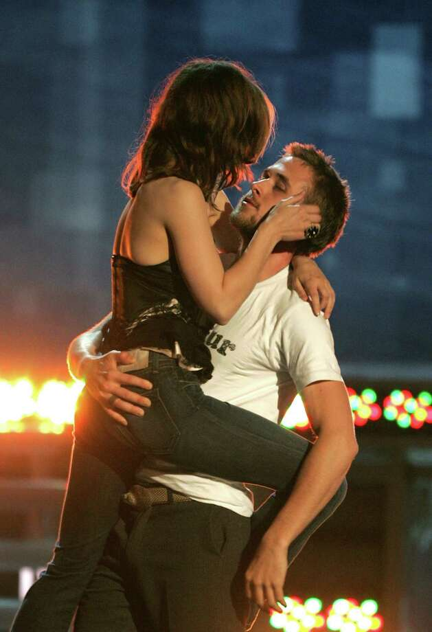 Actress Rachel McAdams (left) and Actor Ryan Gosling accept the award for Best Kiss for The Notebook onstage during the 2005 MTV Movie Awards at the Shrine Auditorium on June 4, 2005 in Los Angeles, California. Photo: Kevin Winter, Getty Images / 2005 Getty Images