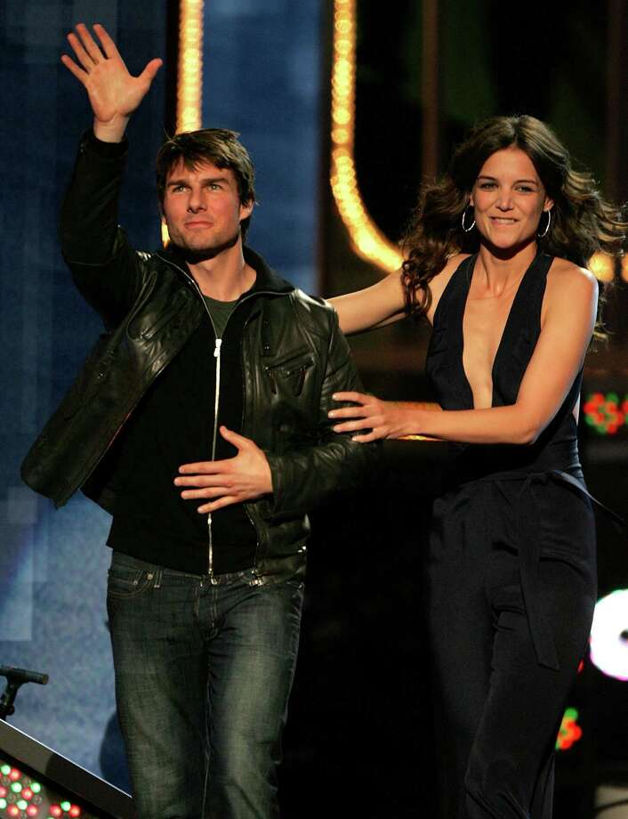 New couple Tom Cruise and Katie Holmes appear onstage during the 2005 MTV Movie Awards at the Shrine Auditorium June 4, 2005 in Los Angeles, California. Photo: Kevin Winter, Getty Images / 2005 Getty Images