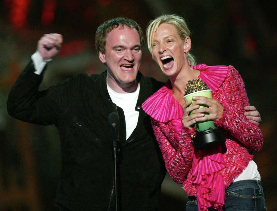 "Director Quentin Tarantino joins actress Uma Thurman as she accepts the award for ""Best Fight"" for ""Kill Bill"" on stage at the 2004 MTV Movie Awards at the Sony Pictures Studios on June 5, 2004 in Culver City, California. Photo: Kevin Winter, Getty Images / 2004 Getty Images"