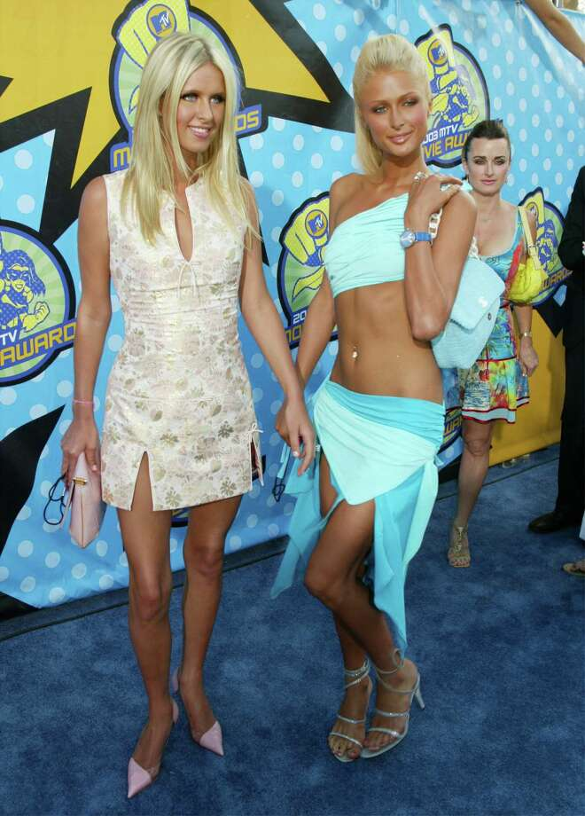 The Hilton sisters hit the red carpet. Nicky and Paris Hilton attend The 2003 MTV Movie Awards held at the Shrine Auditorium on May 31, 2003 in Los Angeles, California. Photo: Kevin Winter, Getty Images / 2003 Getty Images