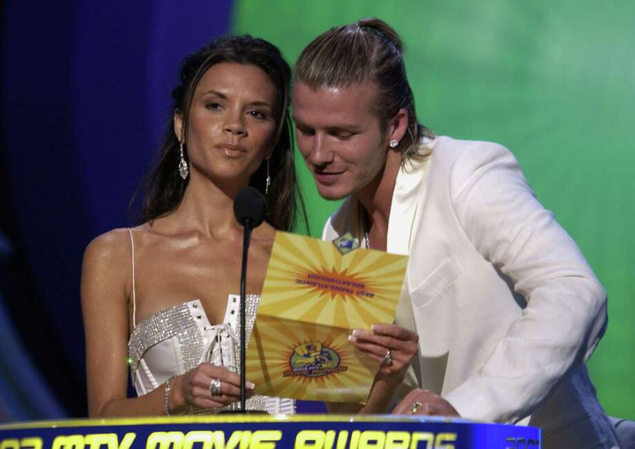 Singer Victoria Beckham and soccer player David Beckham on stage at The 2003 MTV Movie Awards held at the Shrine Auditorium on May 31, 2003 in Los Angeles, California. Photo: Robert Mora, Getty Images / 2003 Getty Images