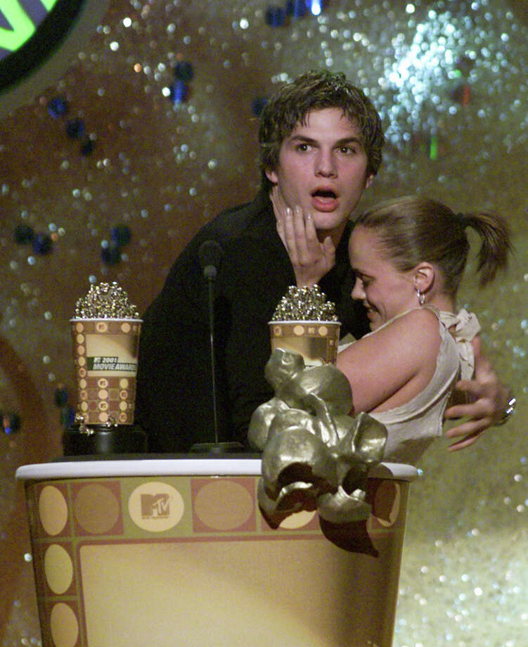 Christina Ricci and Ashton Kutcher react after kissing at the 2001 MTV Movie Awards at the Shrine Auditorium in Los Angeles Saturday, June 2, 2001. Photo: Kevin Winter, Getty Images / Getty Images North America
