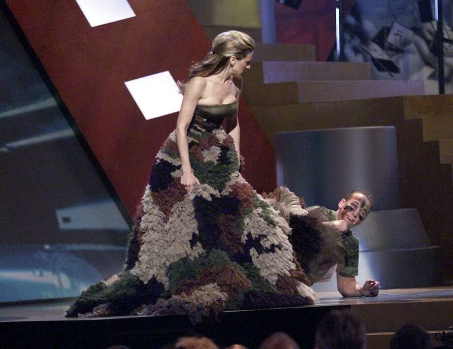 A man climbs out from under the dress of Sarah Jessica Parker, host of the '2000 MTV Movie Awards' at the Sony Pictures Studio in Culver City, Ca. Photo: Frank Micelotta, Getty Images / Getty Images North America