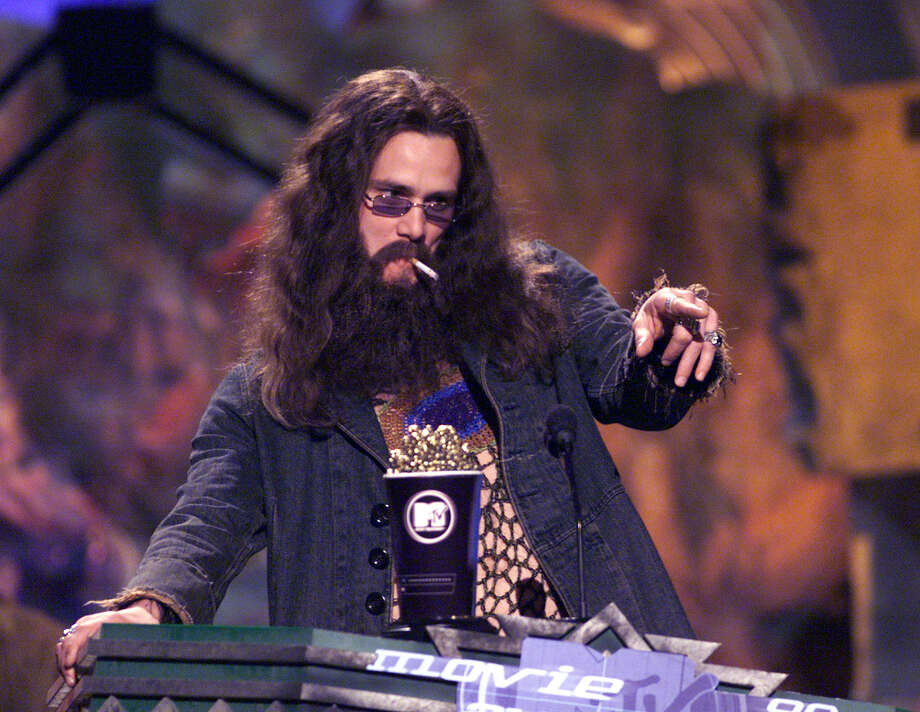 Jim Carrey accepting the award for Best Male Performance for his role in the Truman Show on the 1999 MTV Movie Awards at the Barker Hanger in Los Angeles, CA, 6/5/99. Photo: Frank Micelotta, Getty Images / Getty Images North America