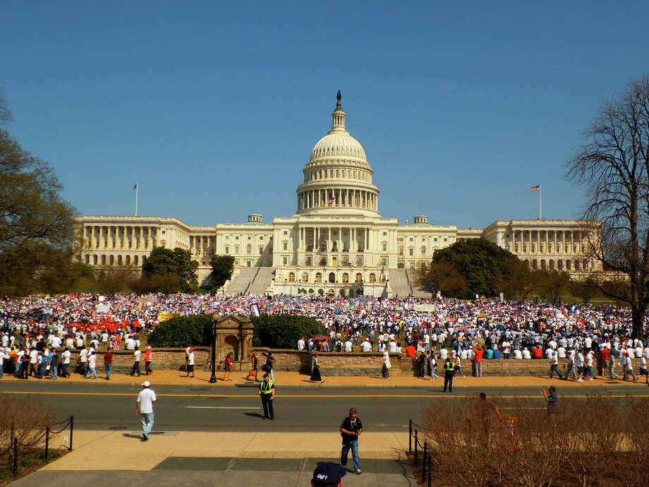 Tens of thousands filled the western lawn of the Capitol on Wednesday afternoon. (Photos by Corey Kane)