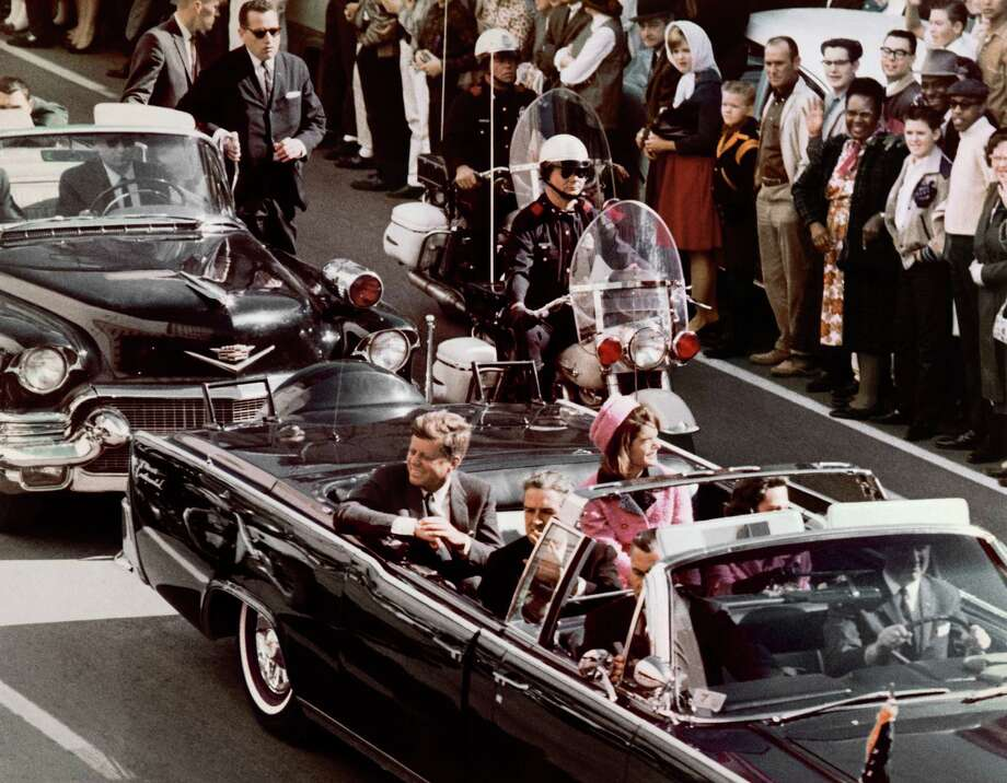 12:29 p.m., November 22, 1963:The Kennedy's' motorcade arrives in Dallas' Dealey Plaza. Photo: Bettmann/Corbis / © Corbis.  All Rights Reserved.