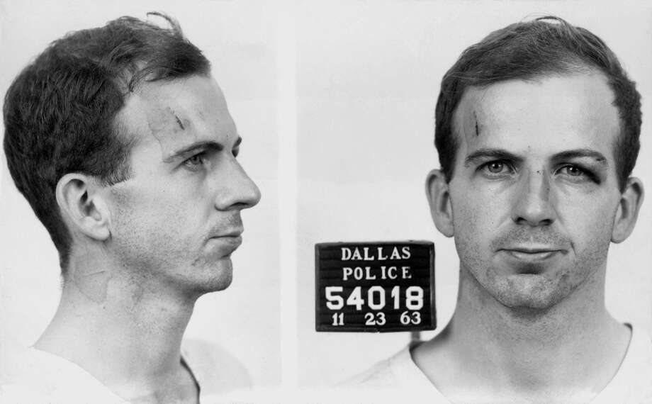 1:50 p.m., November 22, 1963: Dallas police officers arrest Lee Harvey Oswald after a struggle inside the Texas Theatre where Oswald had fled  after killing Tippit. Photo: Police Department, City Of Dallas/Courtesy Les Ellsworth