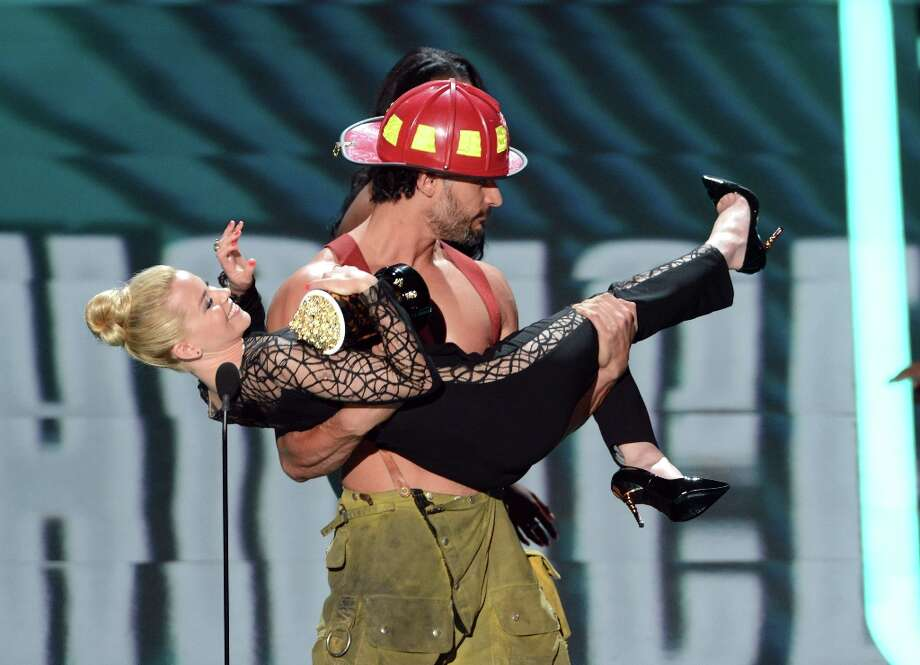 "Actress Elizabeth Banks is helped offstage by shirtless ""Magic Mike"" star Joe Manganiello at the 2012 MTV Movie Awards at Gibson Amphitheatre on June 3, 2012 in Universal City, California.  (Photo by Jeff Kravitz/FilmMagic) Photo: Jeff Kravitz, FilmMagic / 2012 Jeff Kravitz"