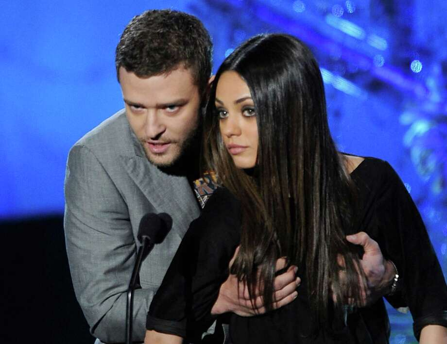 Actors Justin Timberlake (L) and Mila Kunis get up close and personal as they present an award onstage during the 2011 MTV Movie Awards at Universal Studios' Gibson Amphitheatre on June 5, 2011 in Universal City, California. Photo: Kevin Winter, Getty Images / 2011 Getty Images